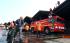 Petugas pemadam kebakaran melakukan pendinginan Gate 3 keberangkatan Luar Negeri yang terbakar di Terminal 2E Bandara Soekarno Hatta, Tangerang, Banten, Minggu (5/7). Kebakaran yang menghanguskan ruang tunggu Terminal 2E masih dalam penyelidikan pihak berwenang. ANTARA FOTO/Muhammad Iqbal/