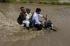 Tiga pria menaiki sepeda motor melewati genangan banjir akibat hujan lebat di Ahmedabad, India, Selasa (28/7). ANTARA FOTO/REUTERS/Amit Dave
