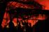 Sejumlah petugas pemadam kebakaran berusaha memadamkan api yang membakar pabrik buku Kiky di Bangak, Boyolali, Jawa Tengah, Jumat (31/7) malam. Menurut pekerja pabrik, kebakaran diduga akibat arus pendek listrik, yang membakar lima gudang penyimpanan kertas rol dan mesin pemotong kertas. ANTARA FOTO/ Aloysius Jarot Nugroho